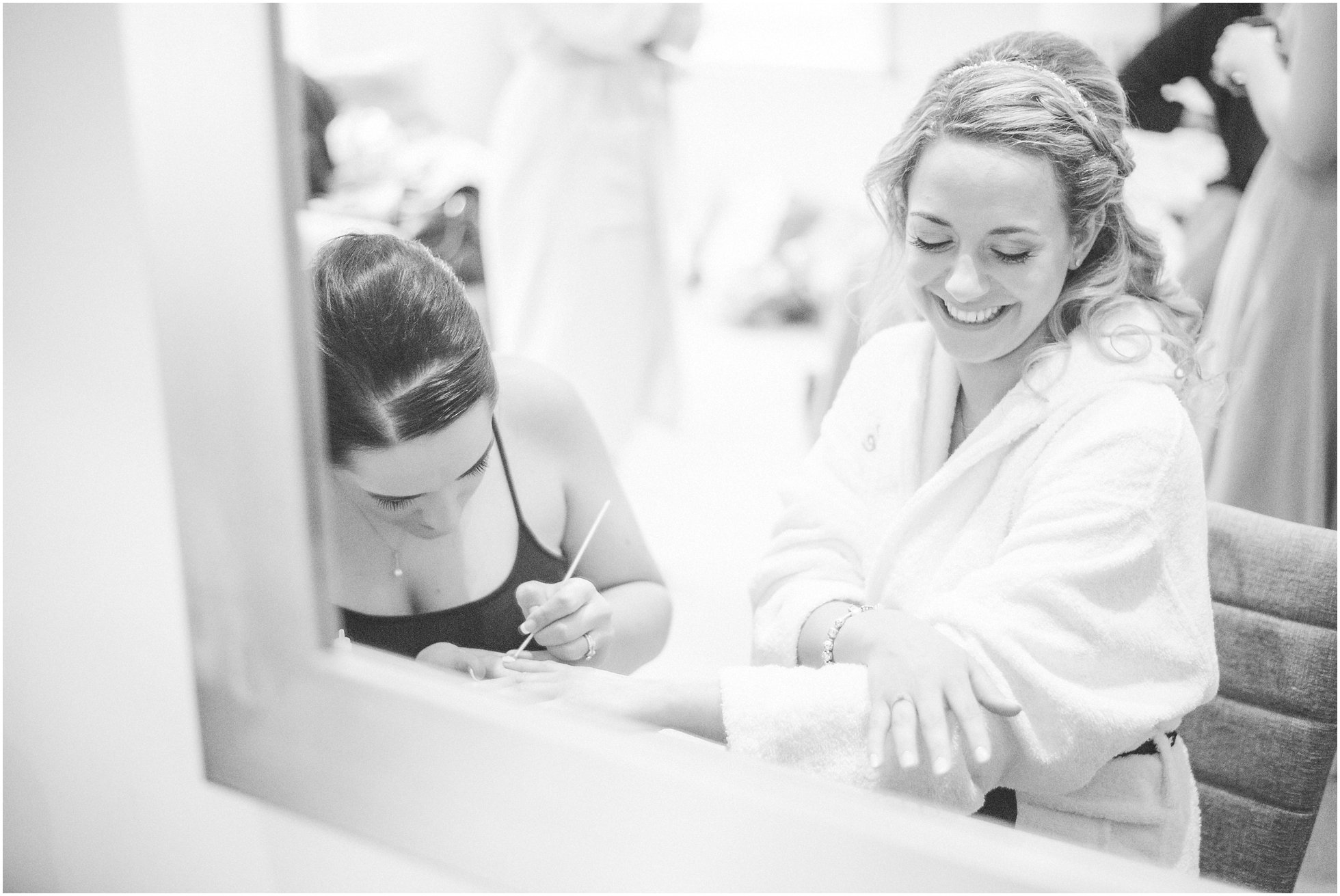 Bride getting ready with her bridesmaid