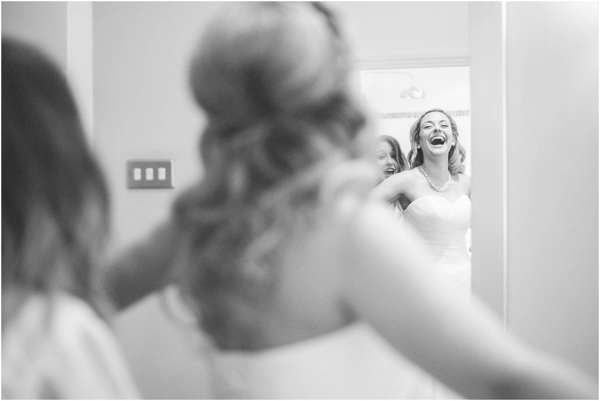 Bride laughter whilst getting ready