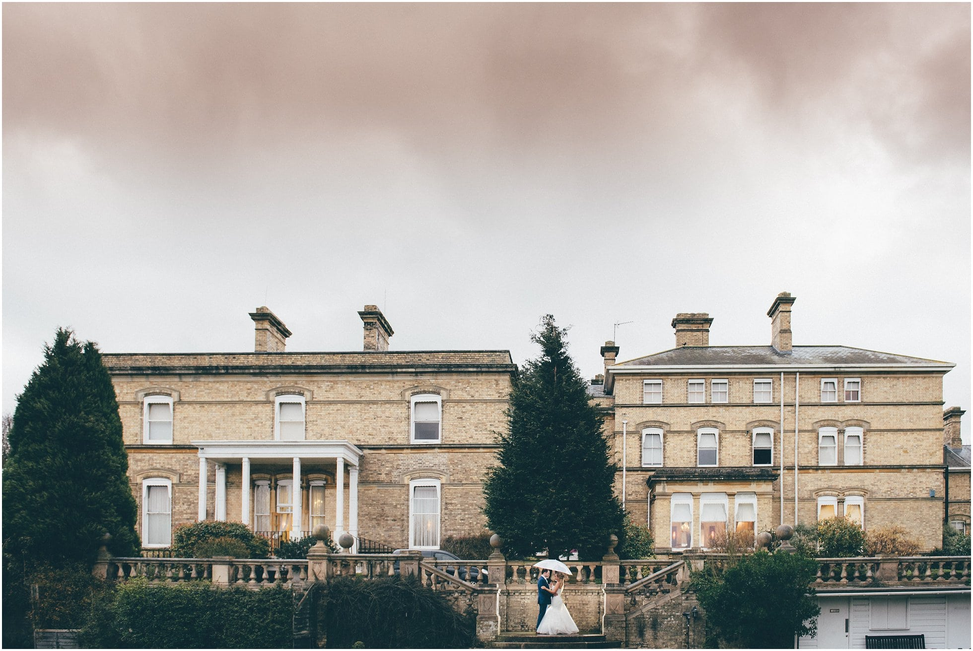 Ponsbourne Park Hotel from far away. Wet wedding weather!