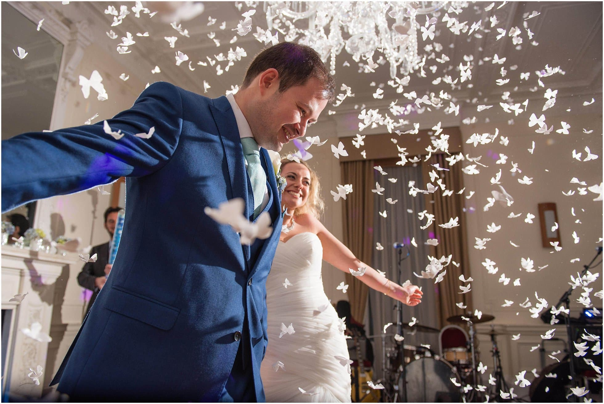 Ponsbourne Park Hotel Wedding Photographer shooting a confetti canon moment during the first dance