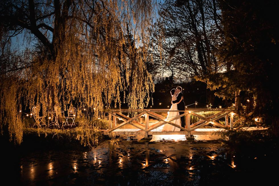 At The Mill Wedding Photographer - super pretty night time shot with these twinkly lights over a stunning lake
