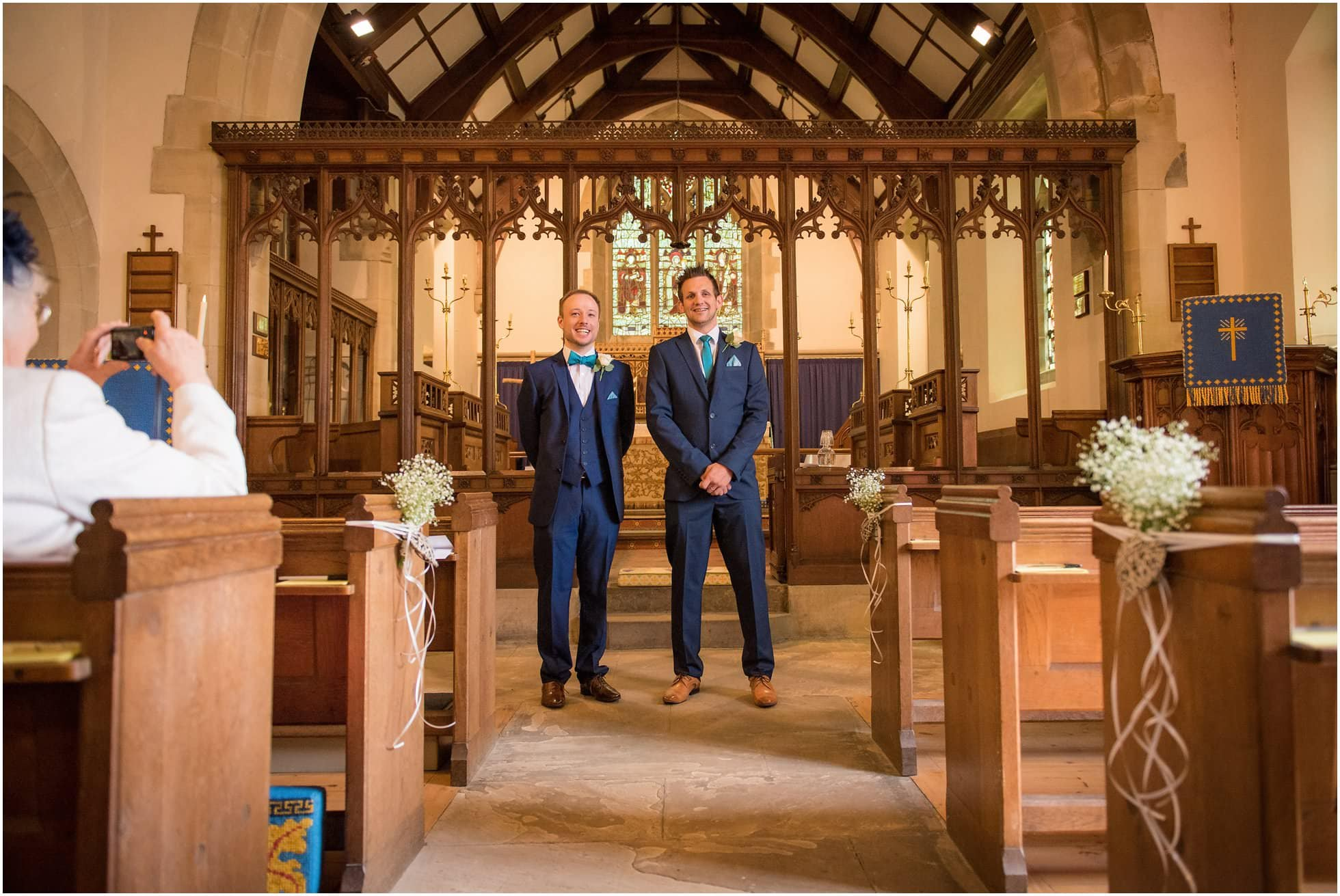 Groom and bestman wait for the stunning bride