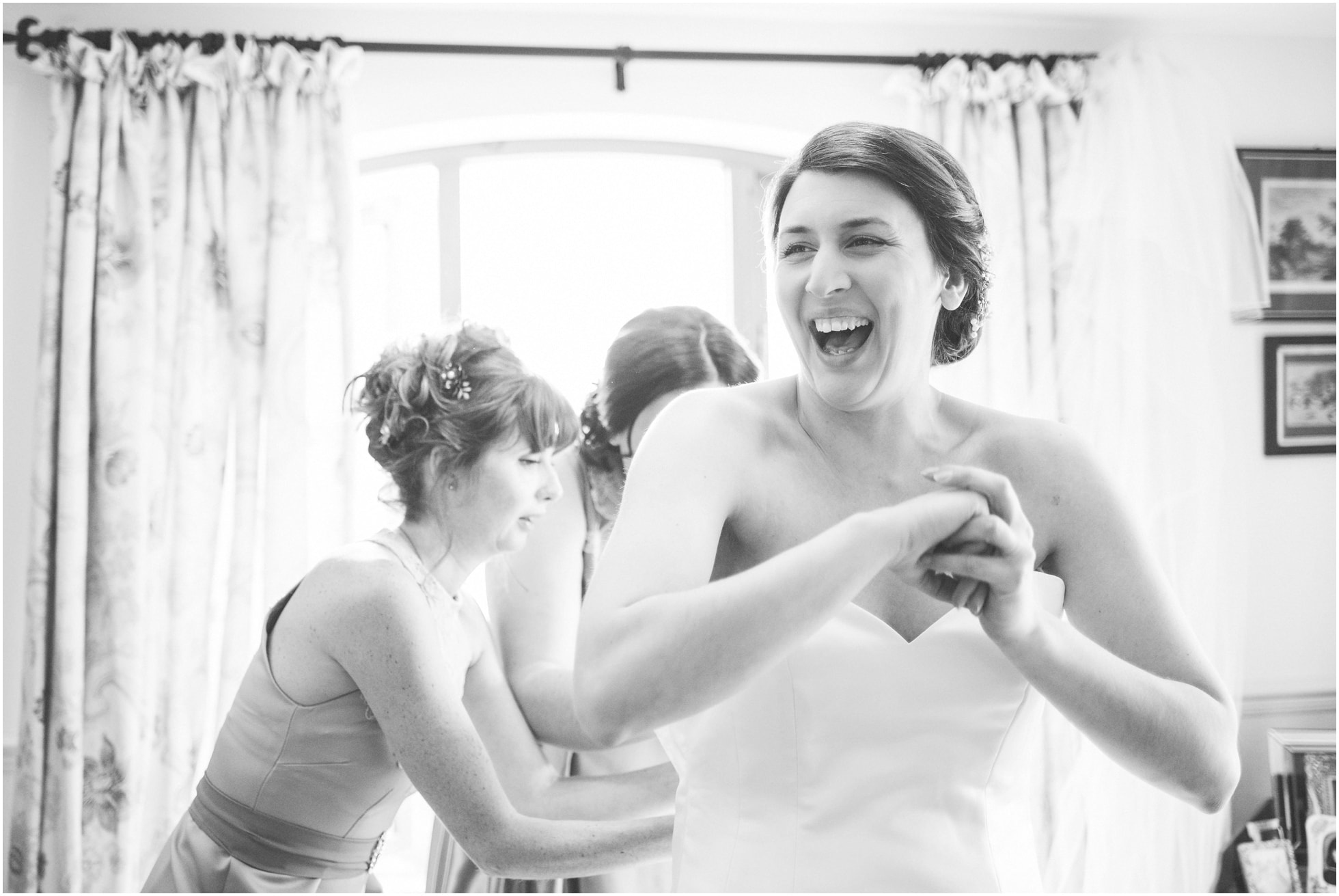 Laughter as the dress is put on