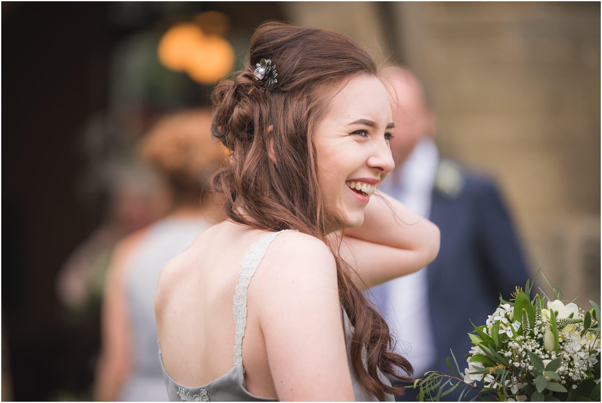 A laughing bridesmaid
