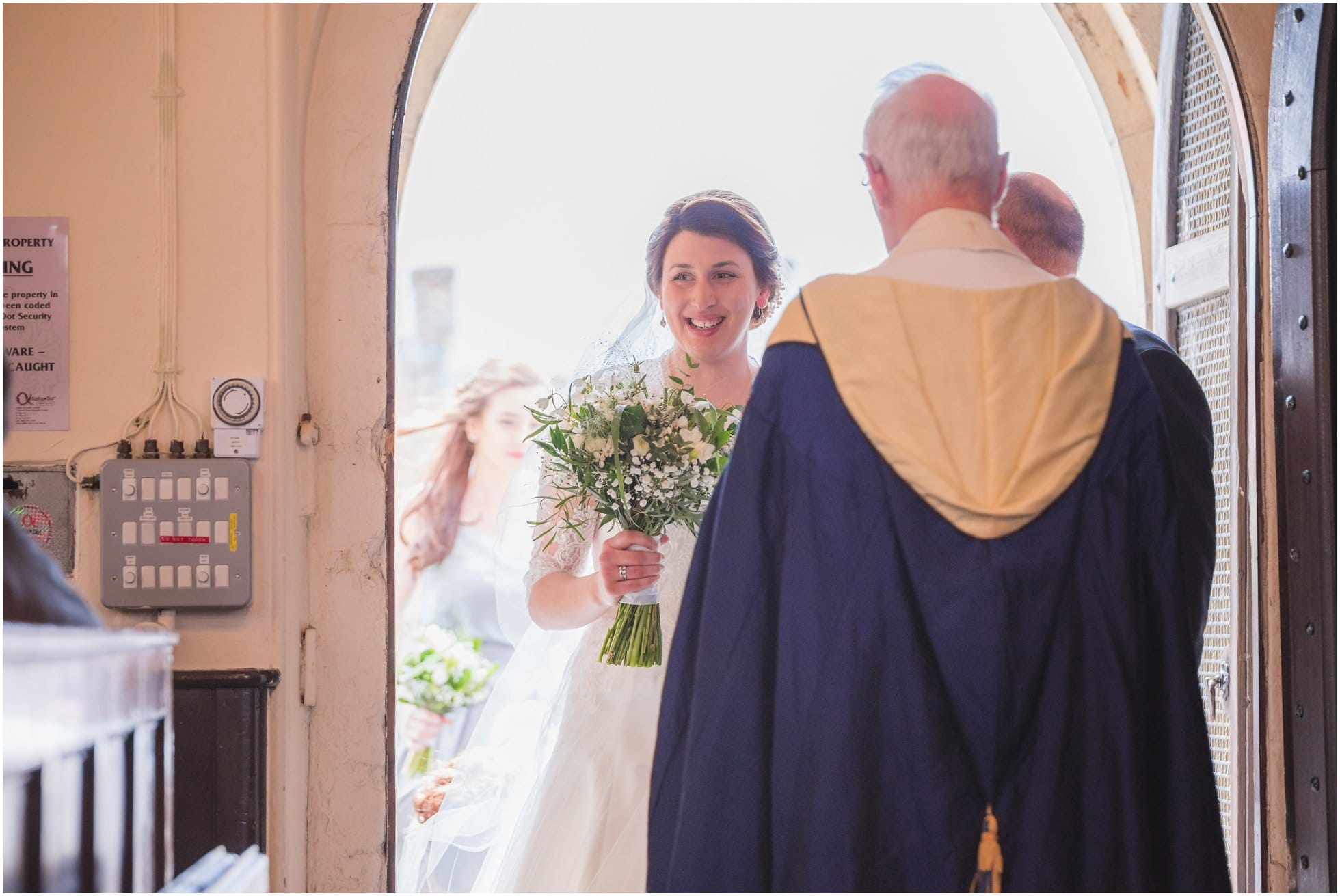 A happy bride about to walk down the aisle