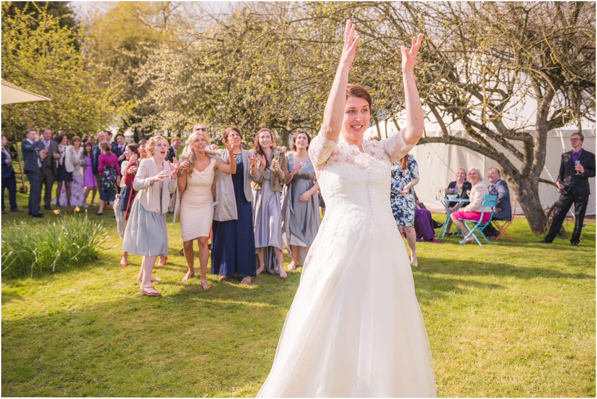 Tossing the bouquet - York Wedding Photographer
