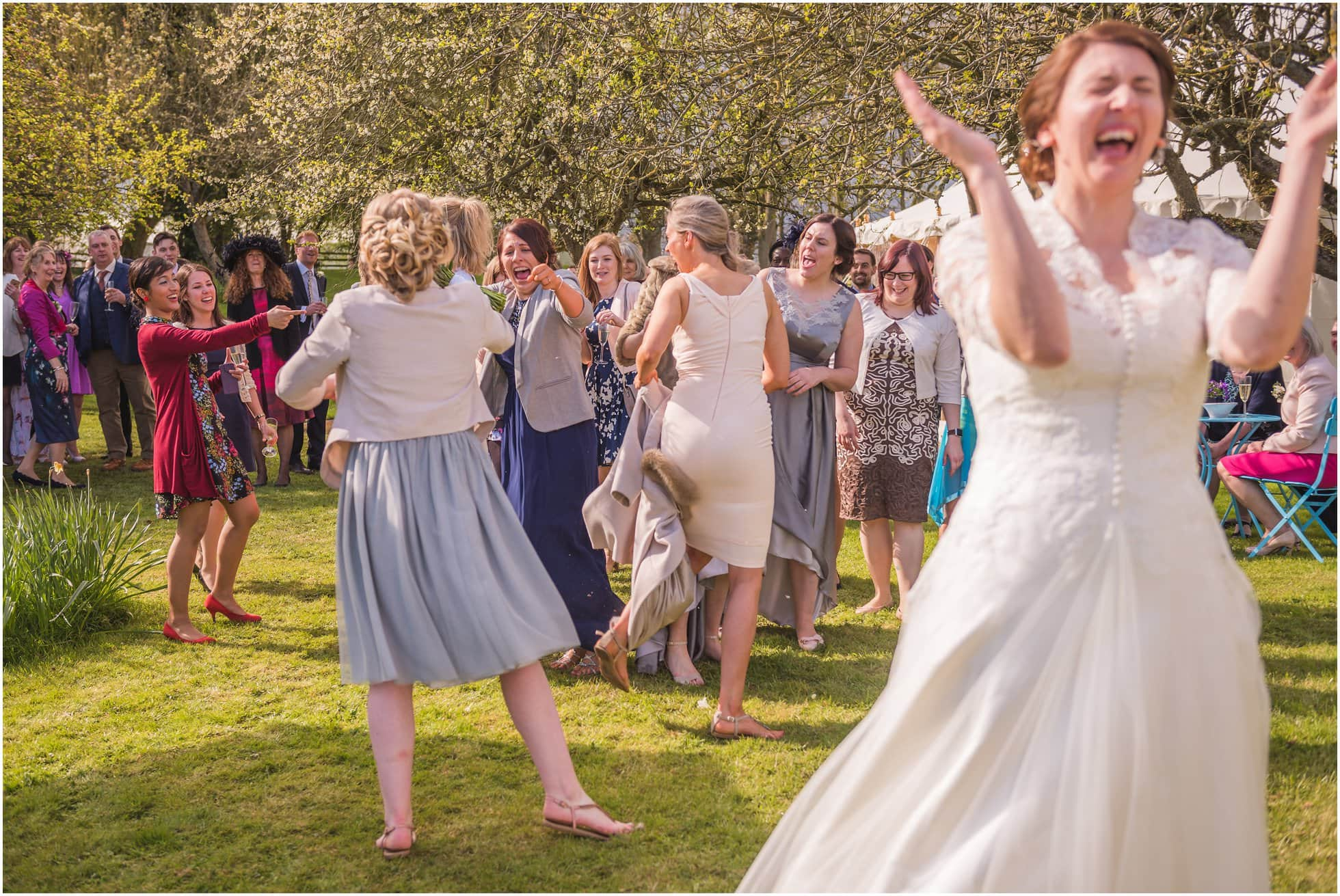 The bride in fits of laughter!