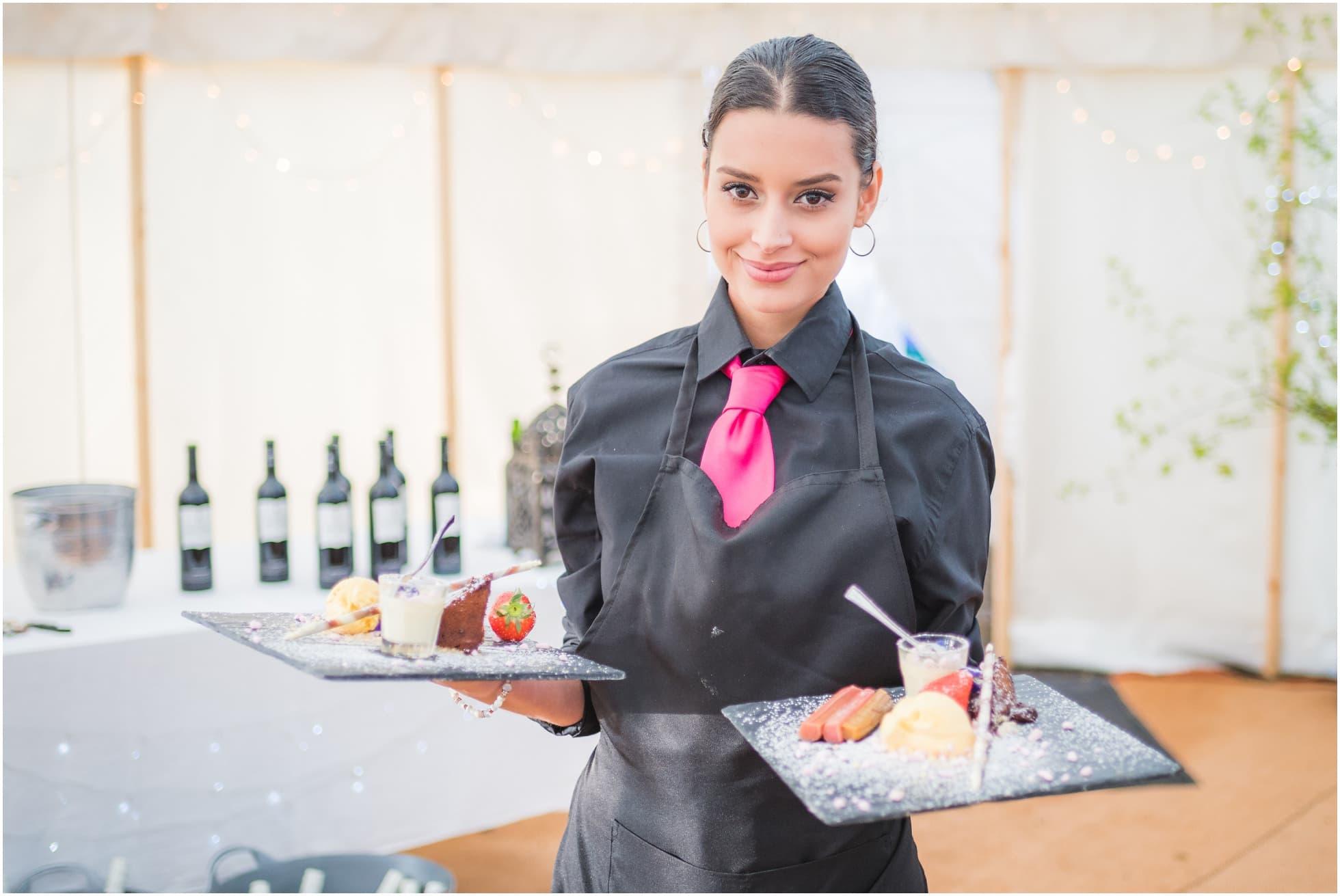 Friends for Dinner waitress serving desert