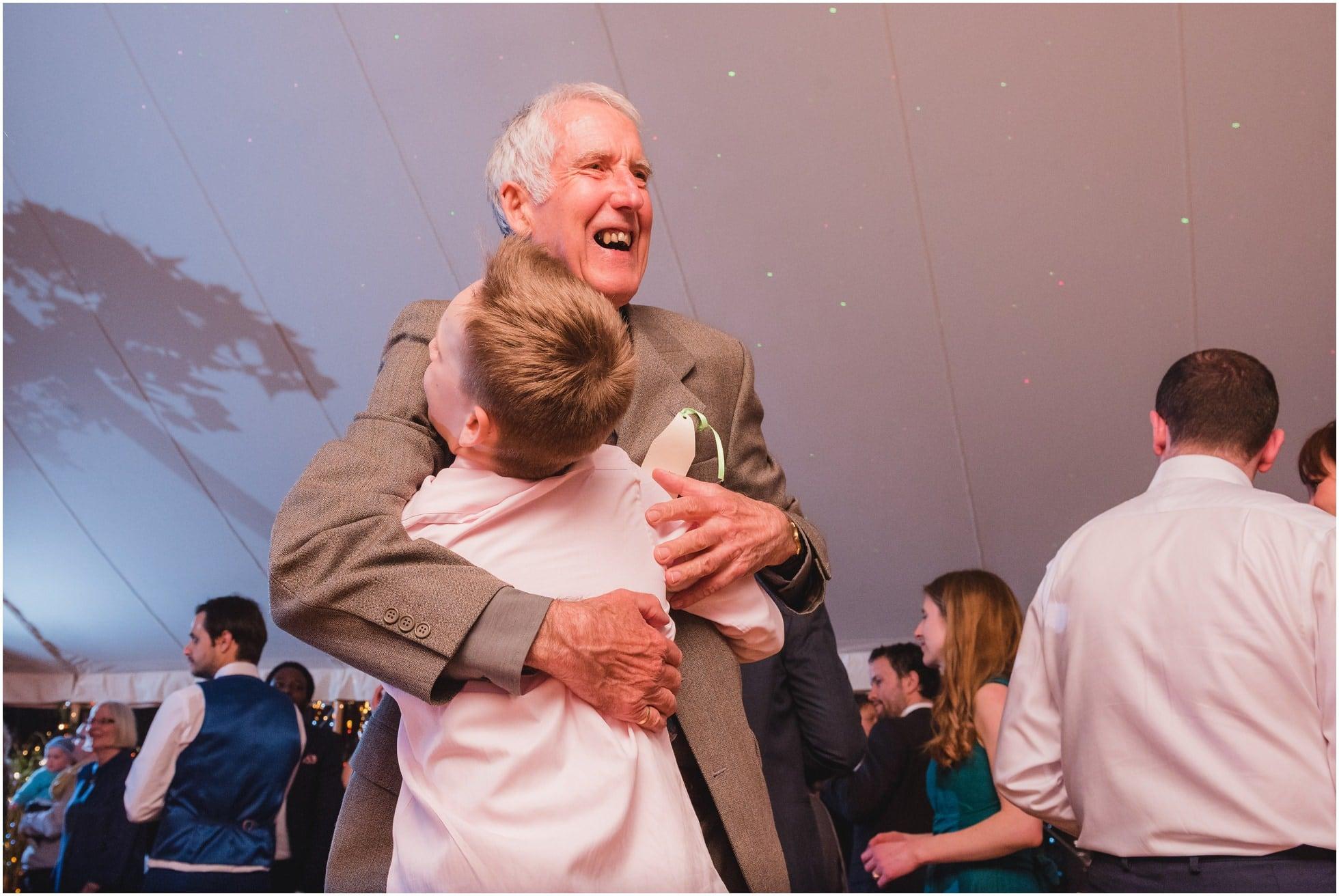 Granddad hugs his grandson