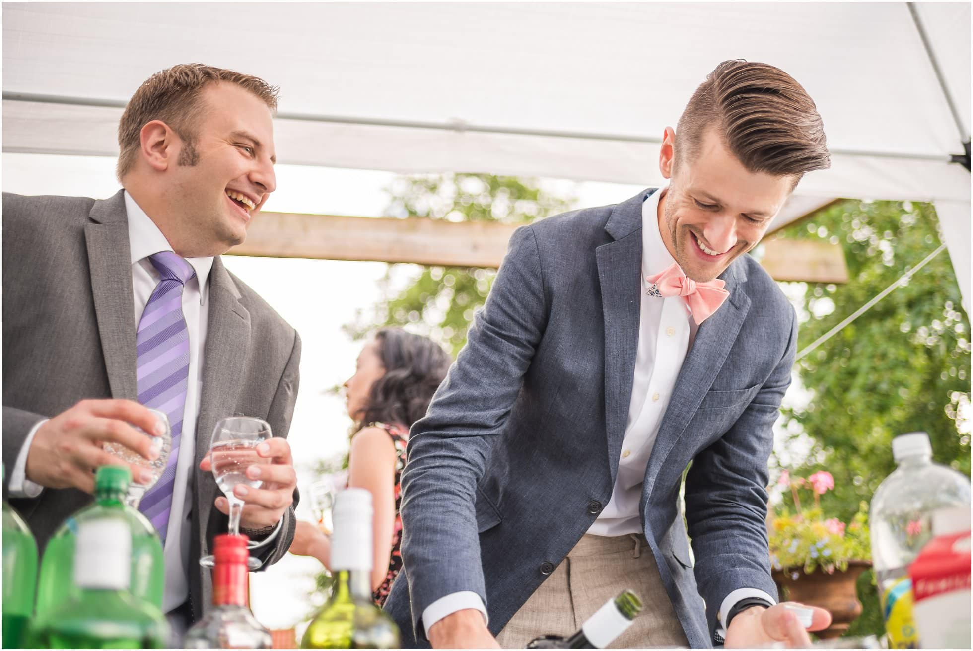 The groom helping himself to drinks