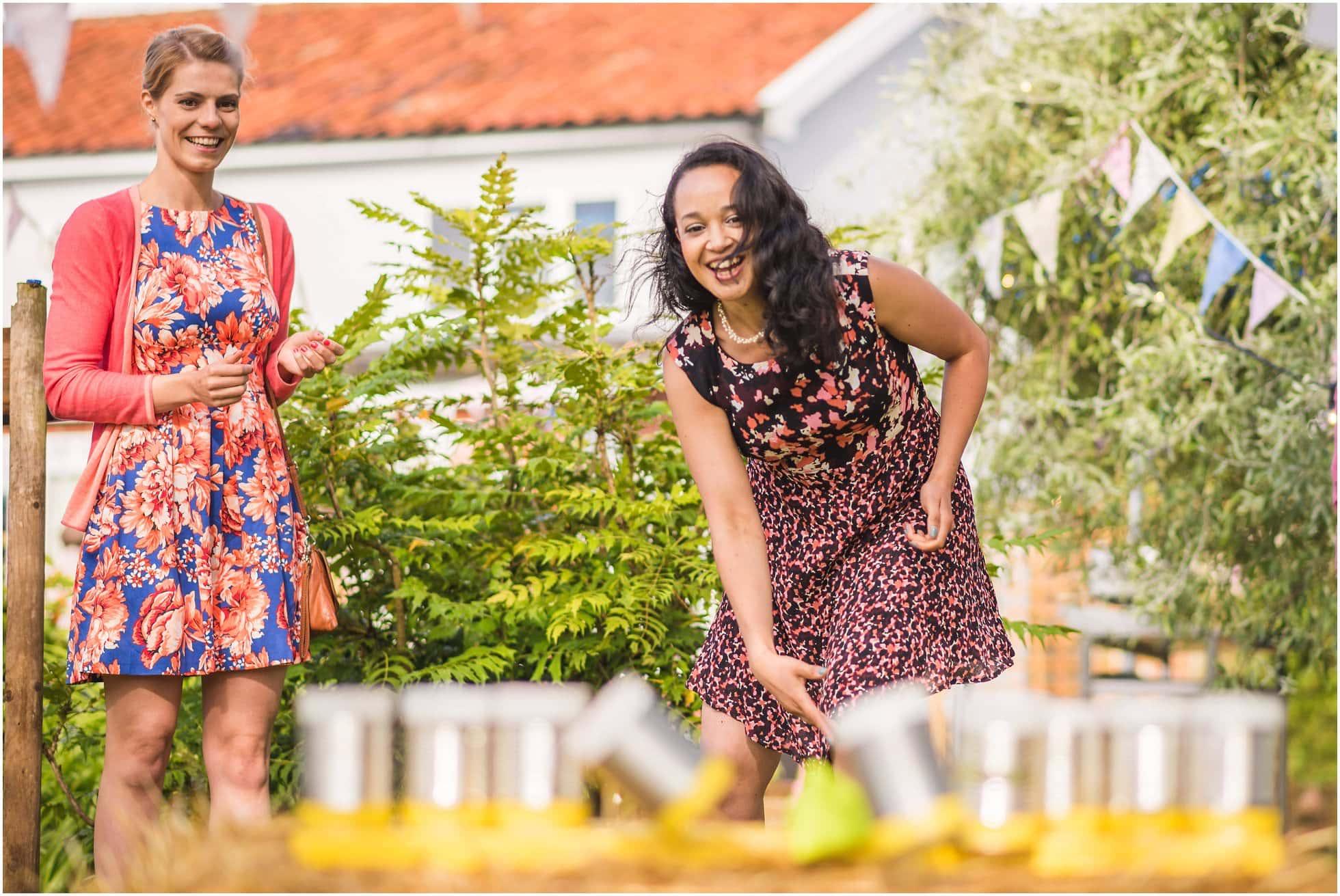 Action shot during Traditional garden games at a sunny suffolk garden wedding photography
