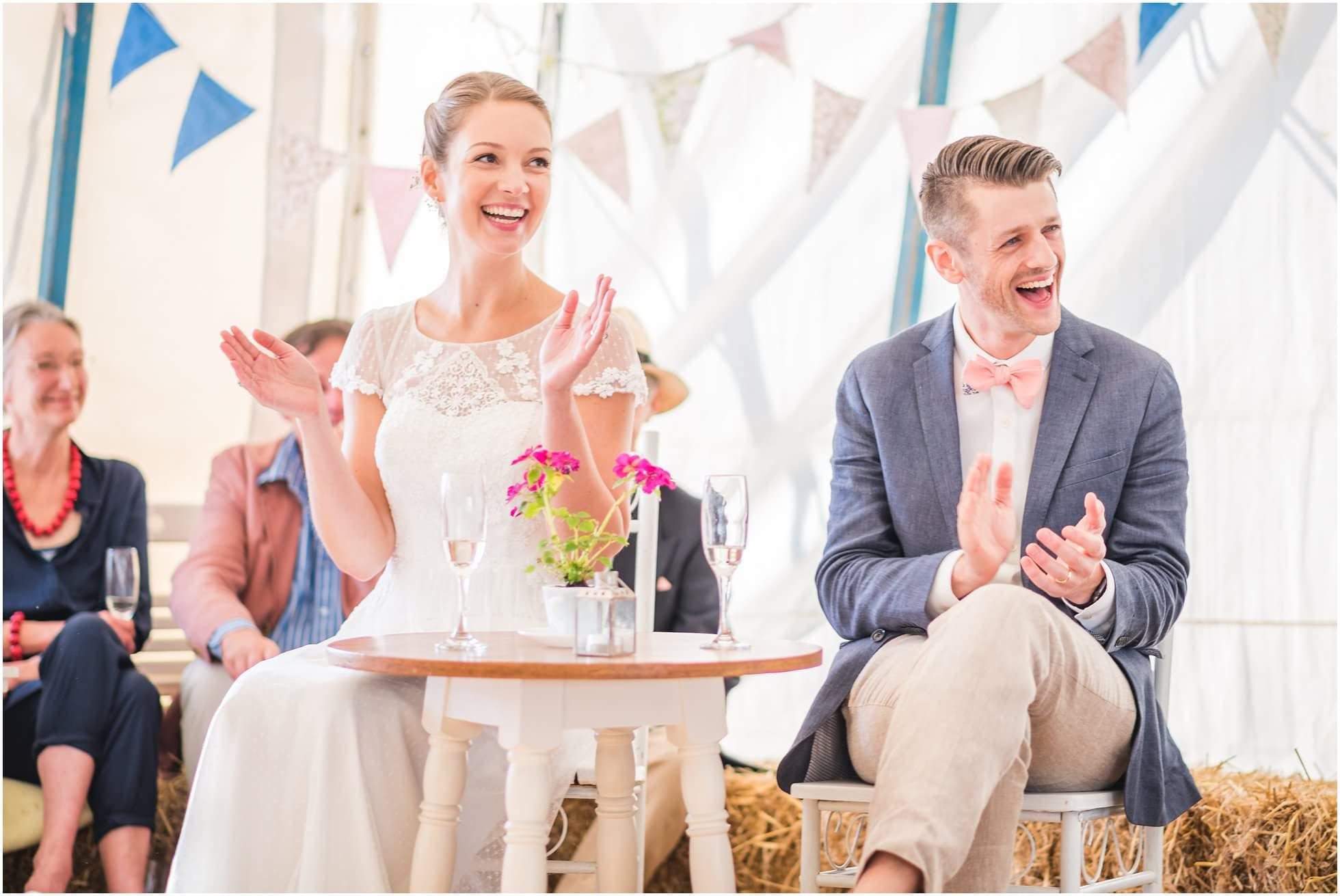 Fun and laughter - the bride and groom during the speeches