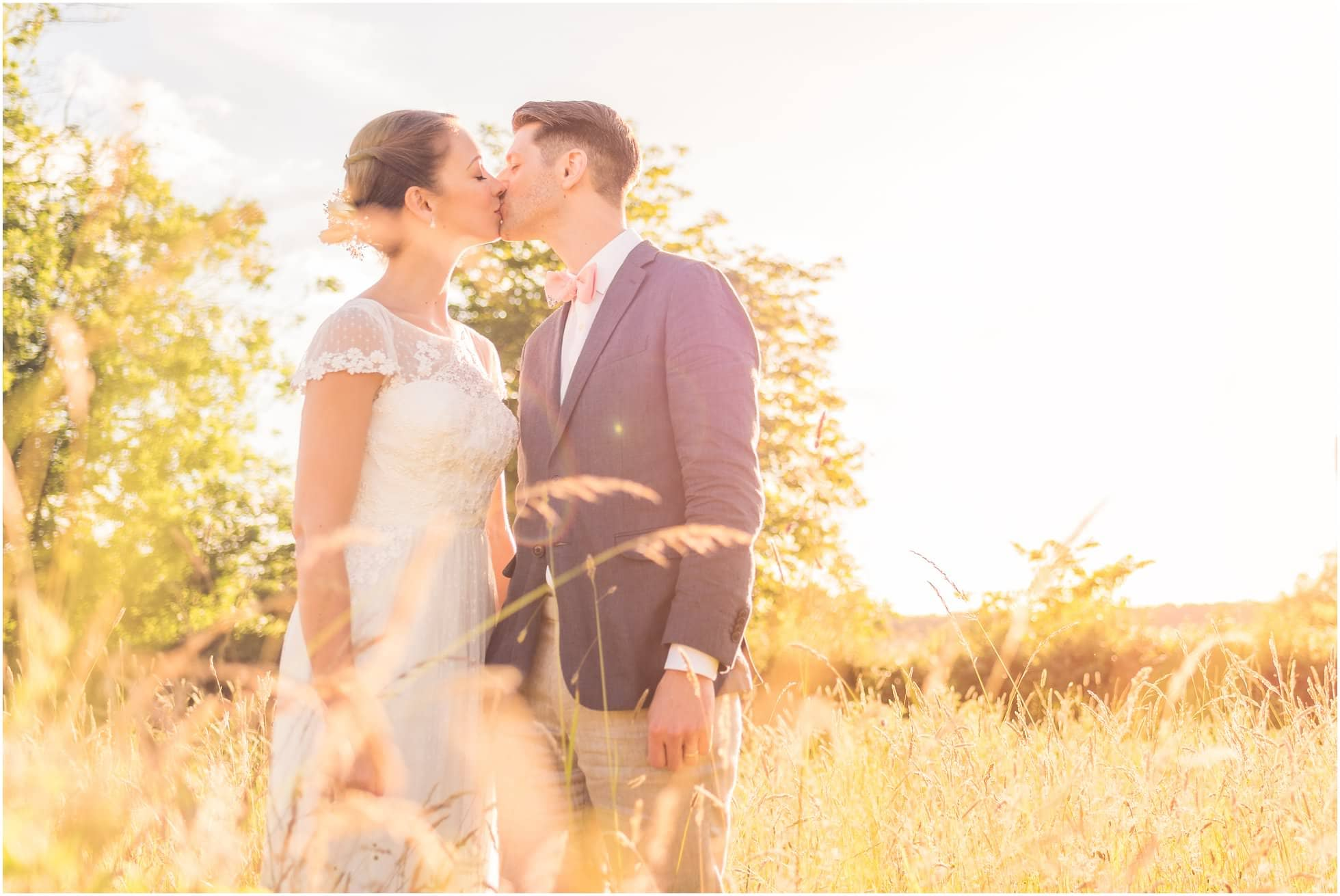 Bride and Groom kiss - Suffolk Wedding Photography golden hour moment