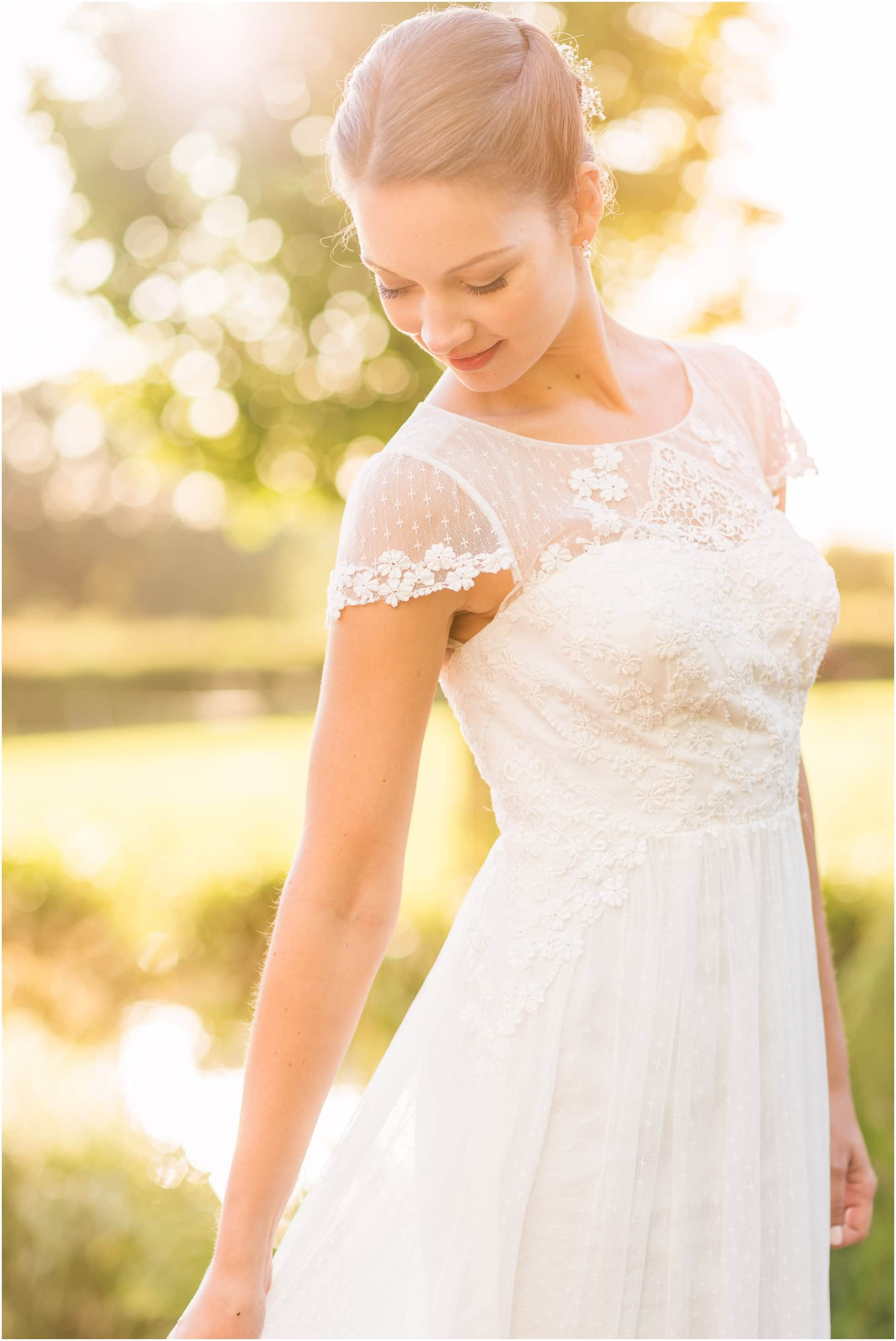 Gorgeous brides dress at sunset - wedding photography golden moment!