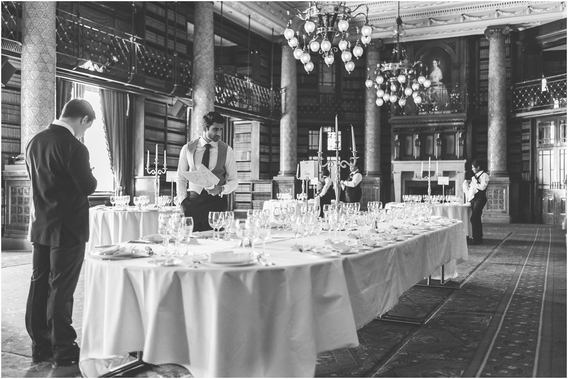 Groom checking the table places