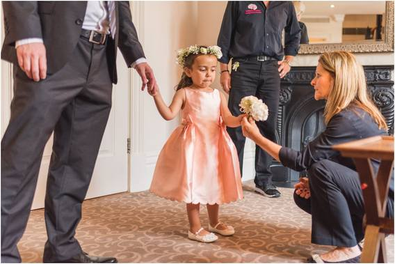 Little bridesmaid receives her bouquet and she