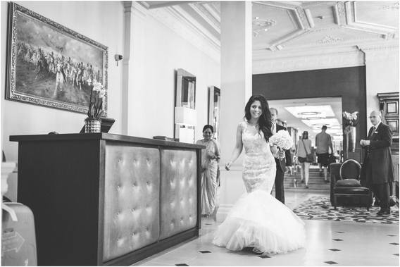 Beautiful bride walks through The Royal Horseguards Hotel to One Whitehall Place.