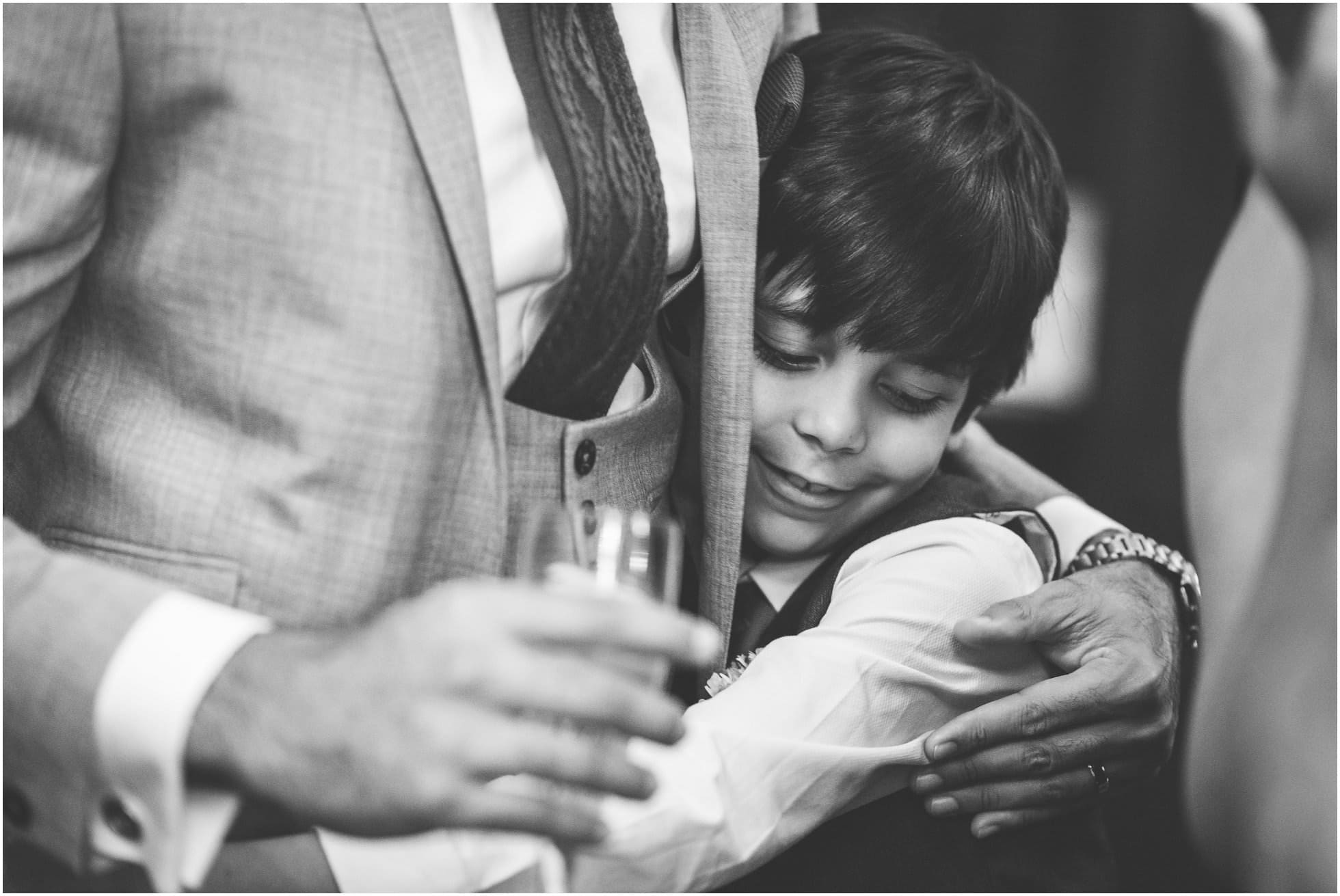 The loveliest hug ever between groom and his nephew