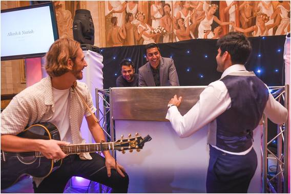 The groom, the singer, the dj sharing a moment