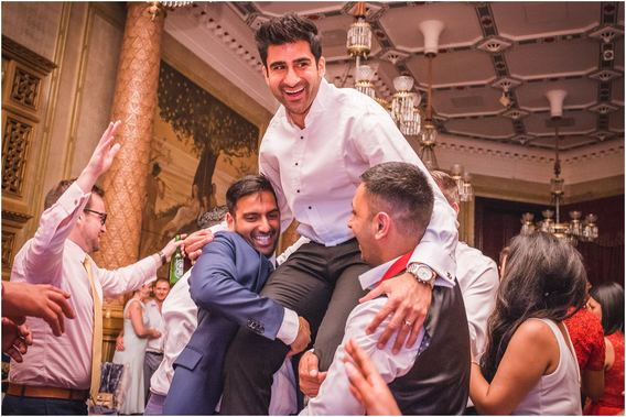 The groom lifted up