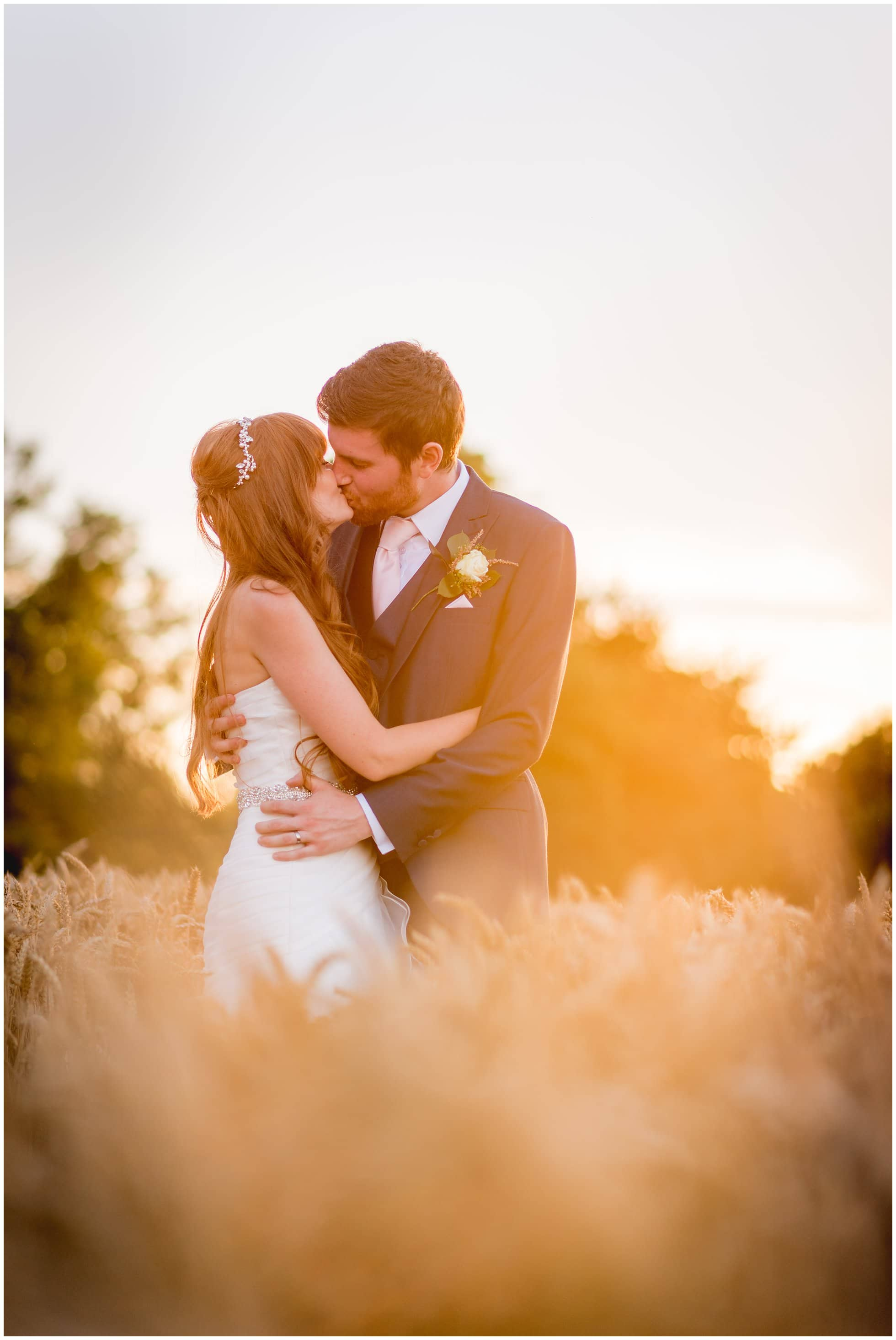 Corn field sunset shot at Maison Talbooth Essex wedding by Winston Sanders