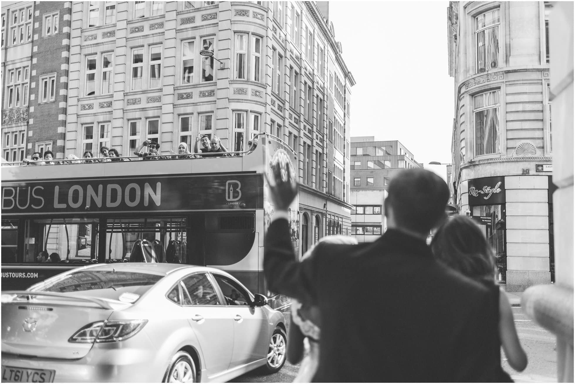 Waving to the passing tourists in London