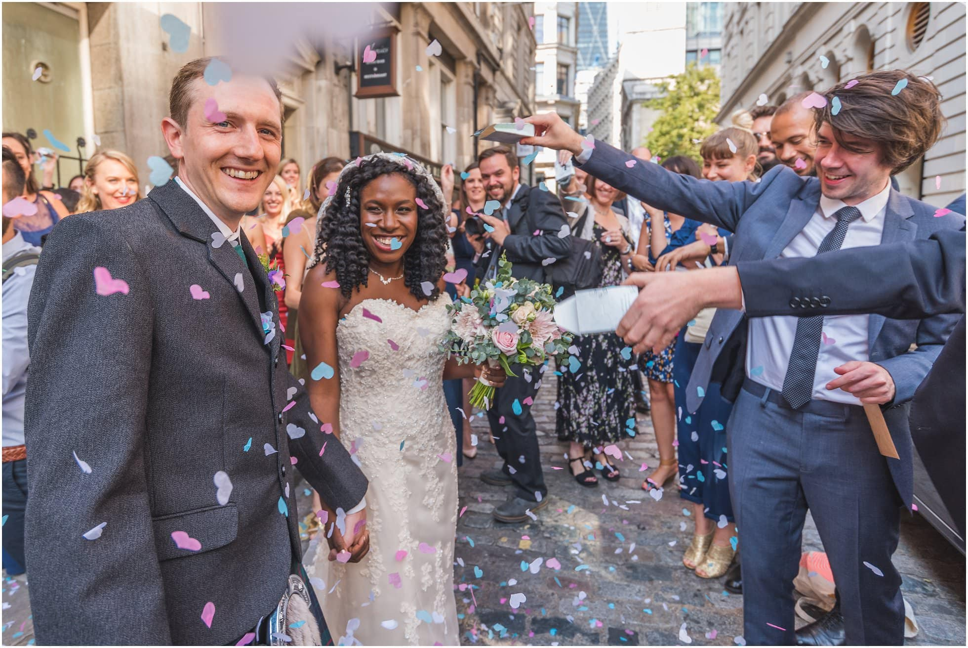 Confetti outside St Mary-At-Hill Church London Wedding