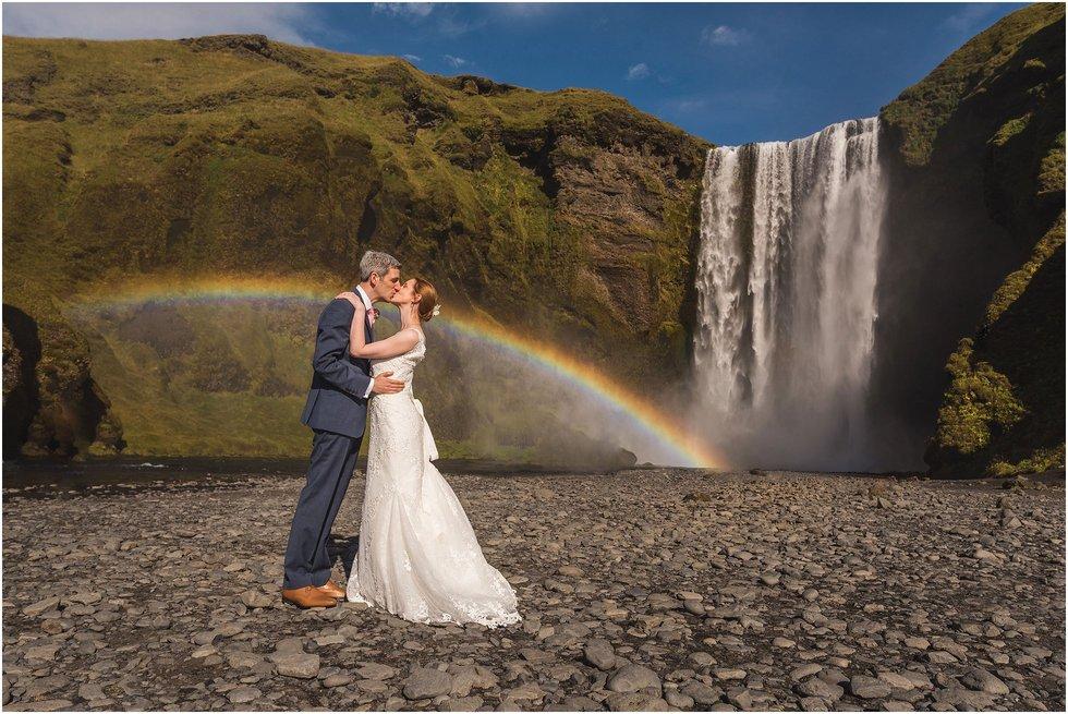 Iceland Wedding Photographer shot of Skógarfoss including rainbow and waterfall