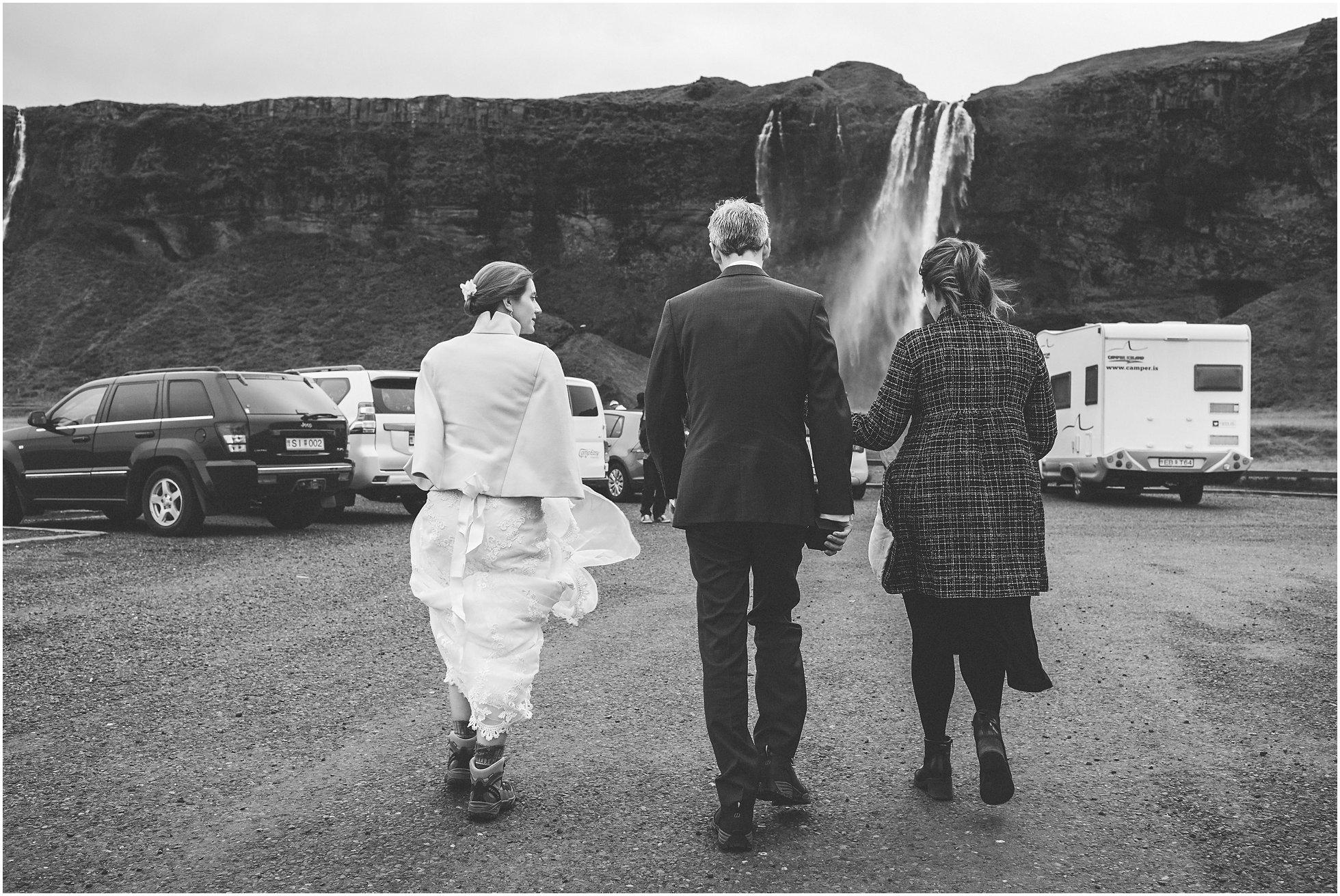 Walking to Seljalandsfoss for their wedding ceremony