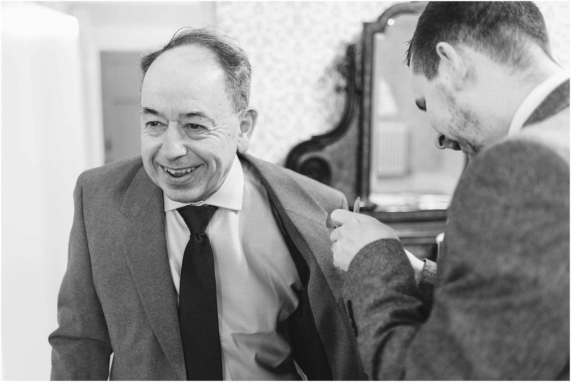 Father of the groom getting ready