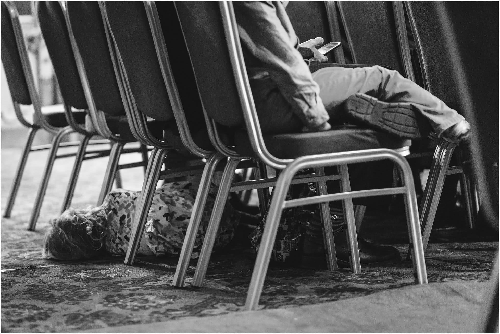 Child under the chairs at Highbury