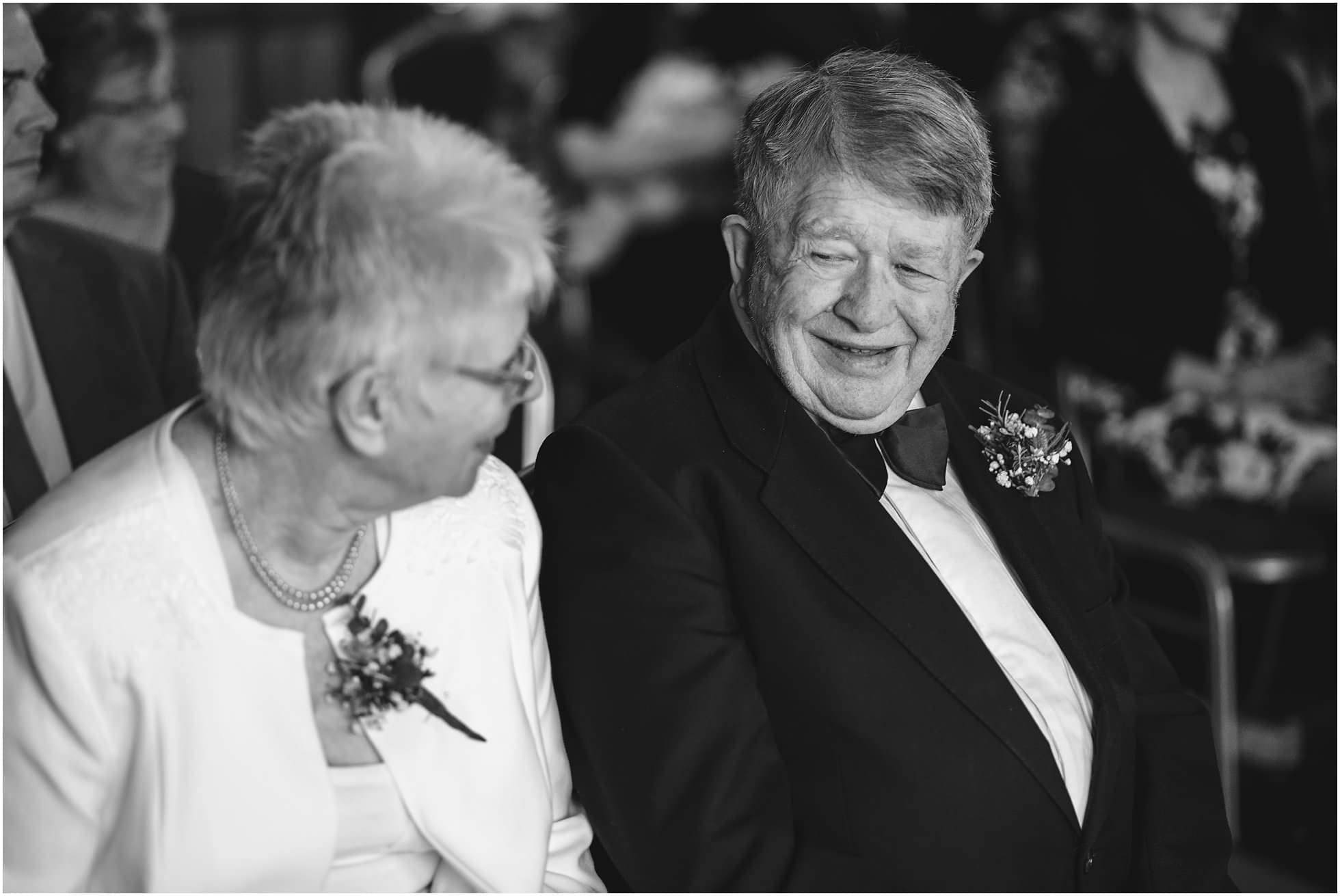 Groom's parents laughing
