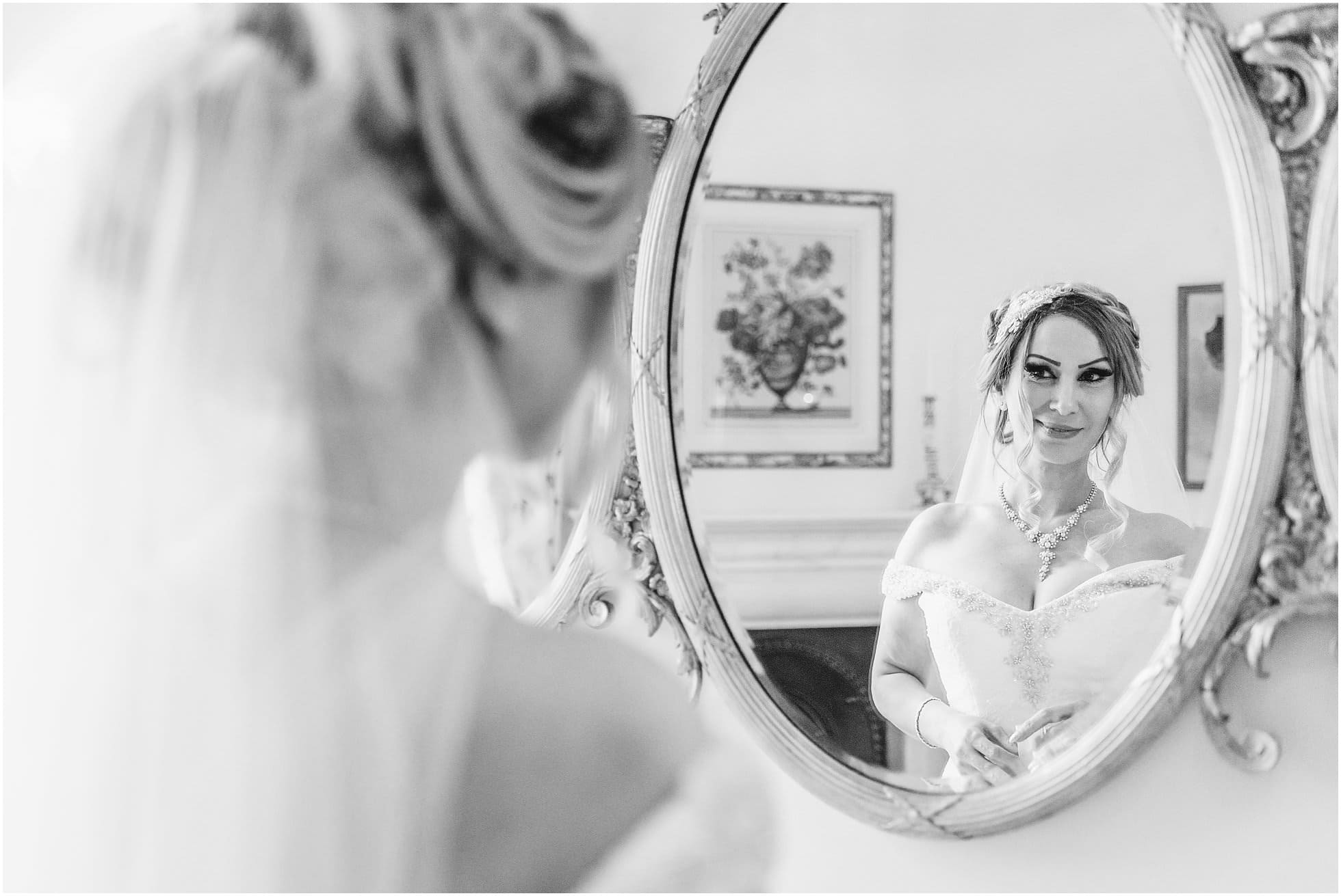 Bride looking stunning in the mirror