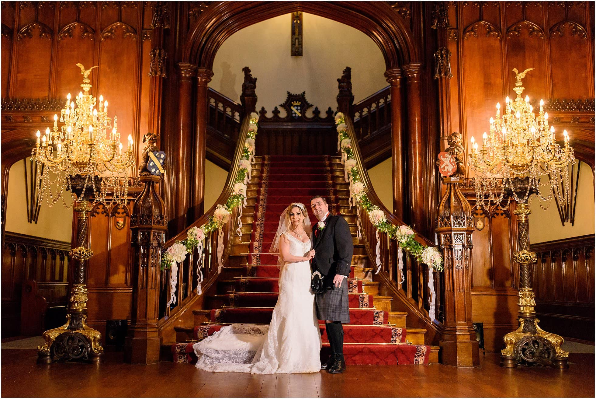 Bride and Groom pose in front of the stair case at Allerton Castle, stunning North Yorkshire Wedding Venue