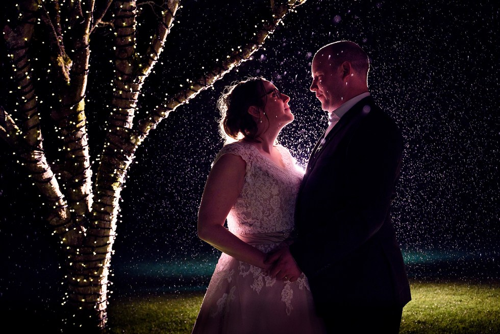 Birtsmorton Court Wedding Venue, Worcestershire - A Wedding Photographer's Dream Venue to take creative shots like this nighttime image in the rain