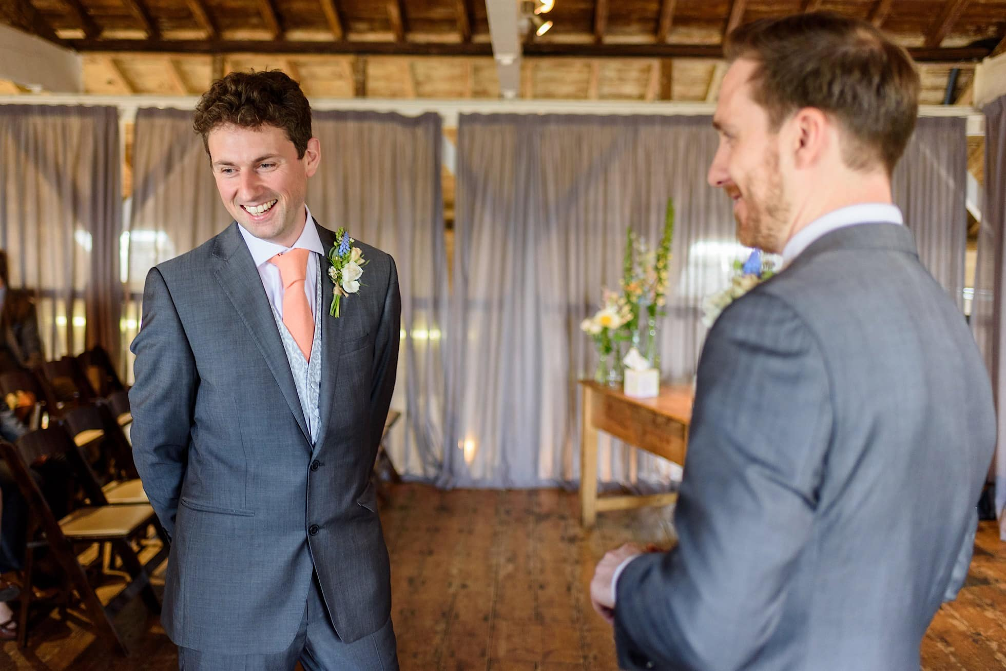 Groom and best man having a laugh