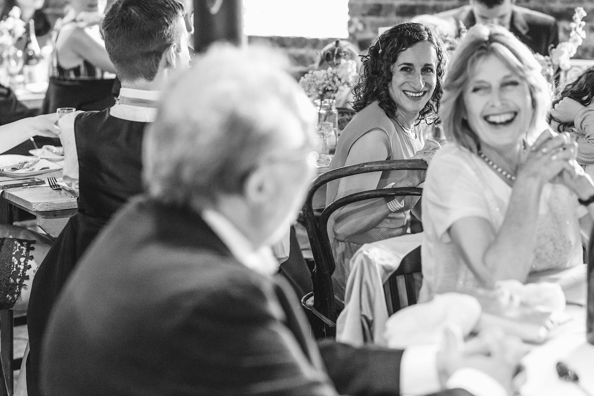 Guests laughing during the East Quay Wedding Speeches