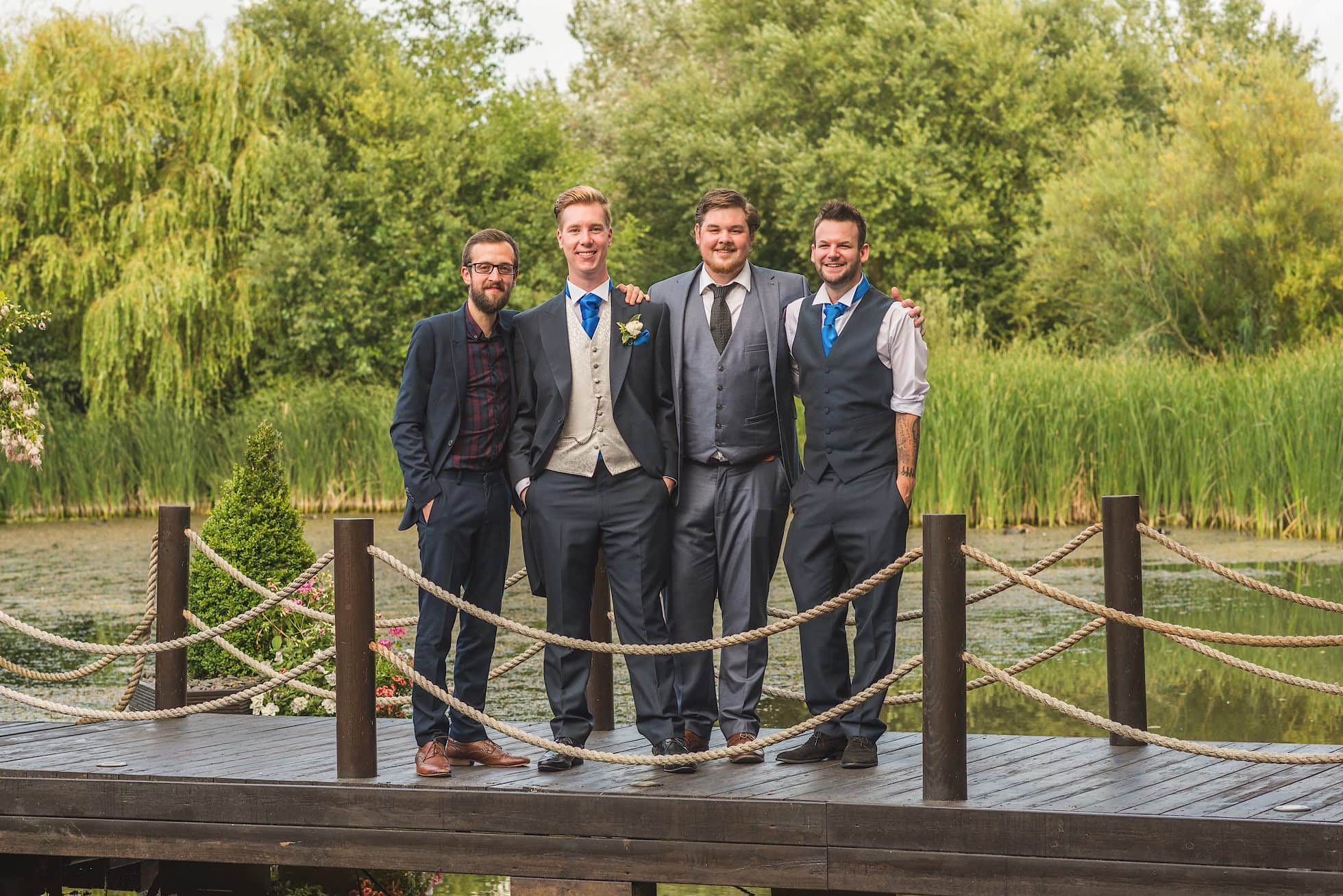 Groom and friends on bridge