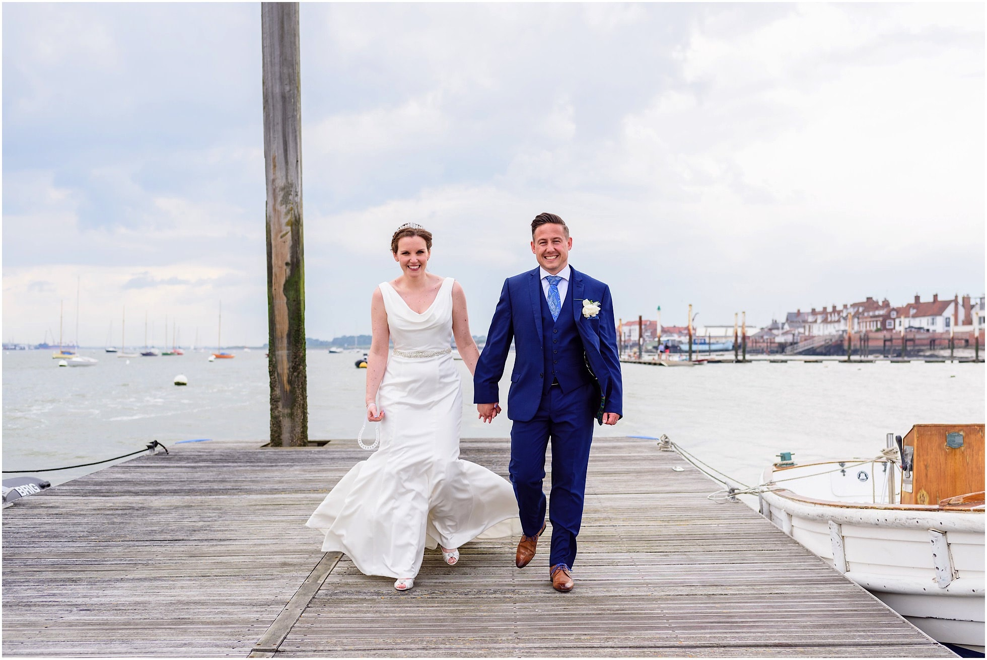 Bride and groom on the pier at the yacht club