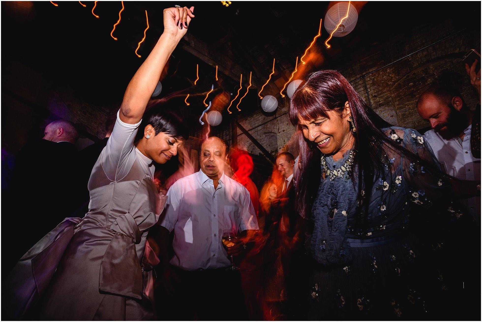 Bride and her parents dancing