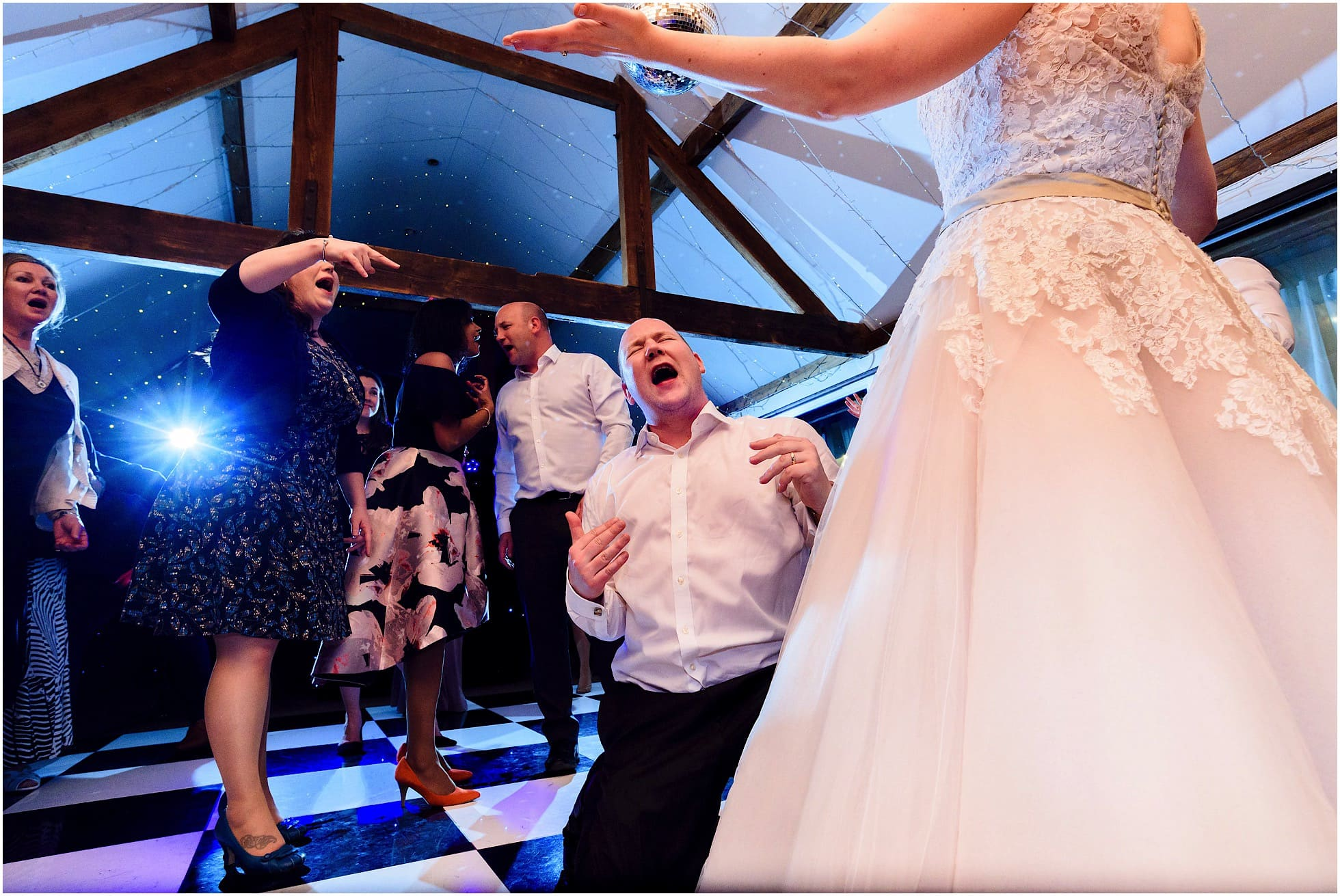 groom singing on the dancefloor