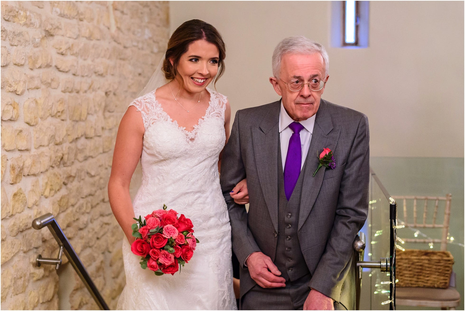 Bride walks up the stairs with Dad