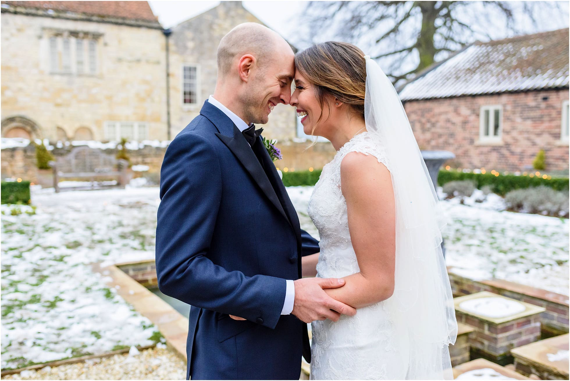 Fun winter wedding photo of bride and groom in yorkshire