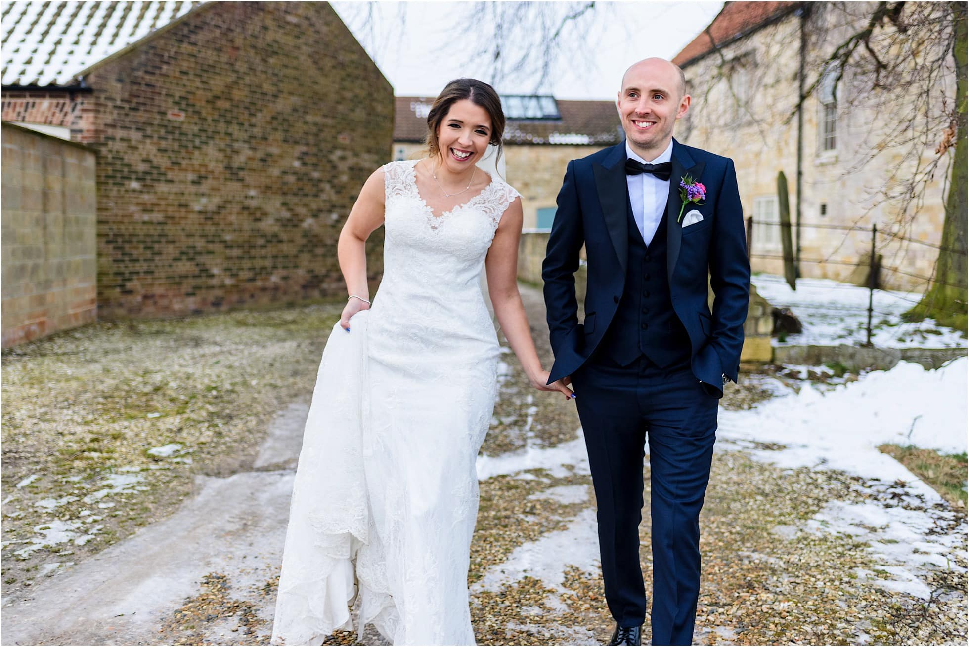 Natural unposed wedding photographer shot of bride and groom in winter