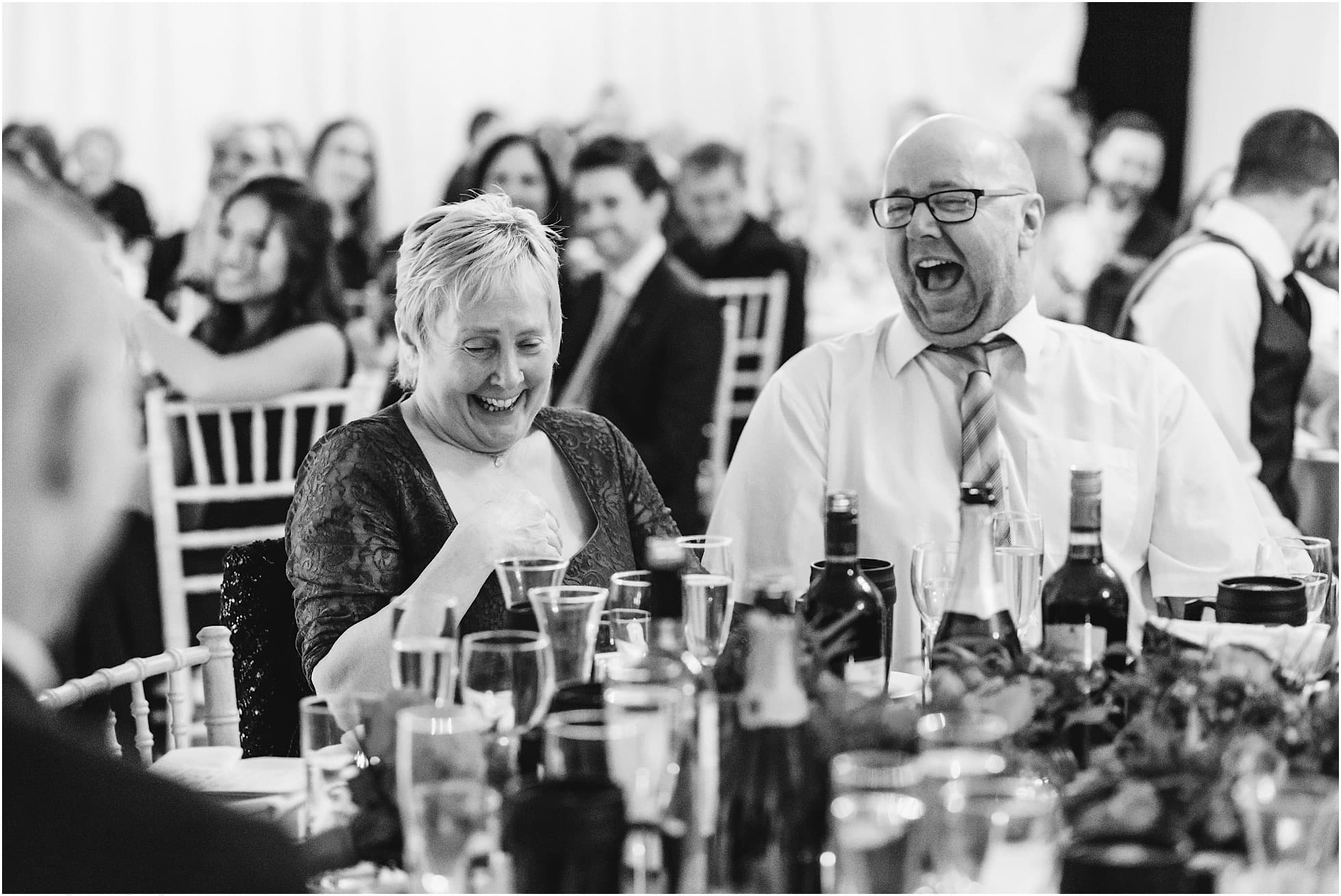 Mum and Dad in fits of laughter at Priory Barn Wedding