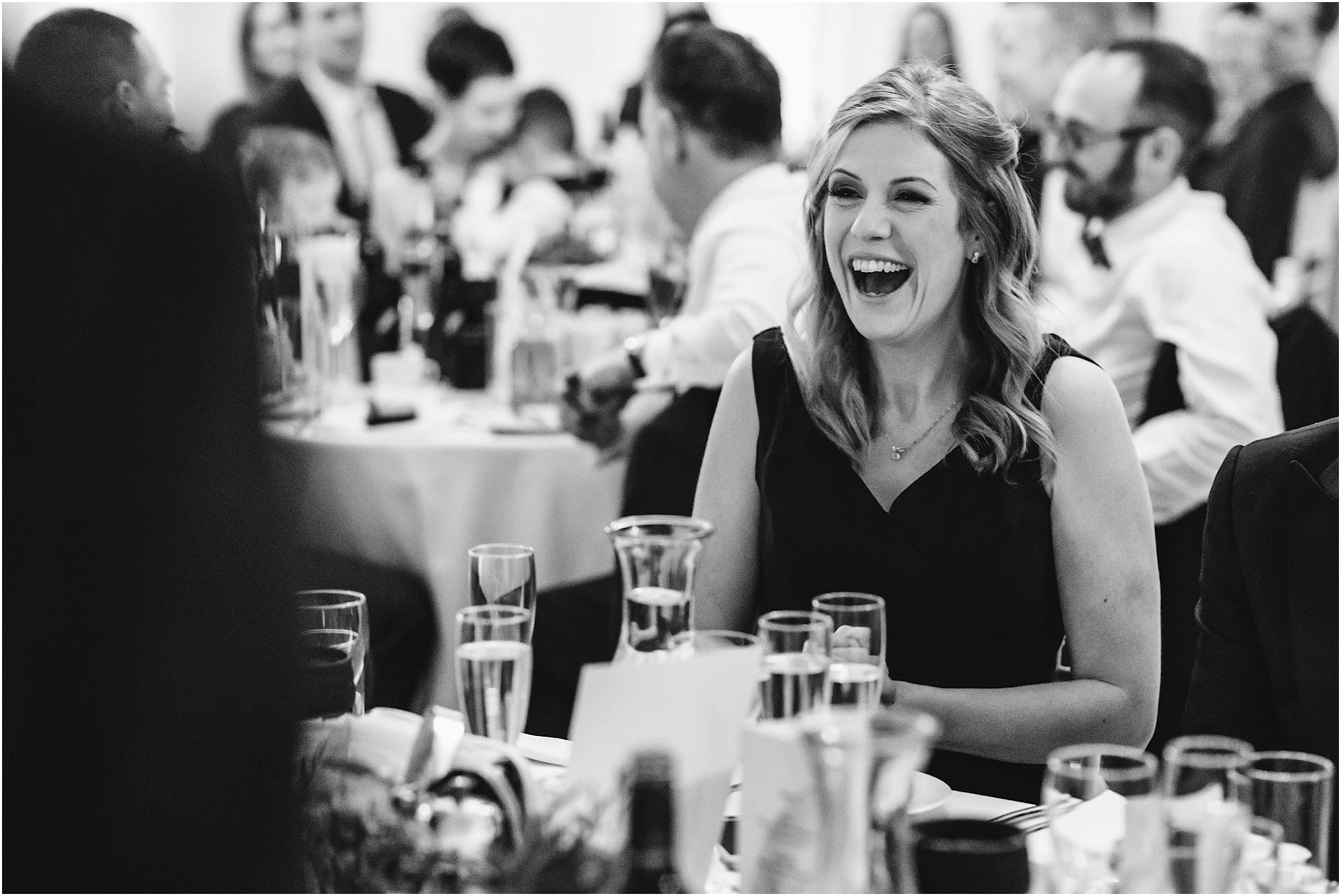 Bridesmaid laughter during the speeches