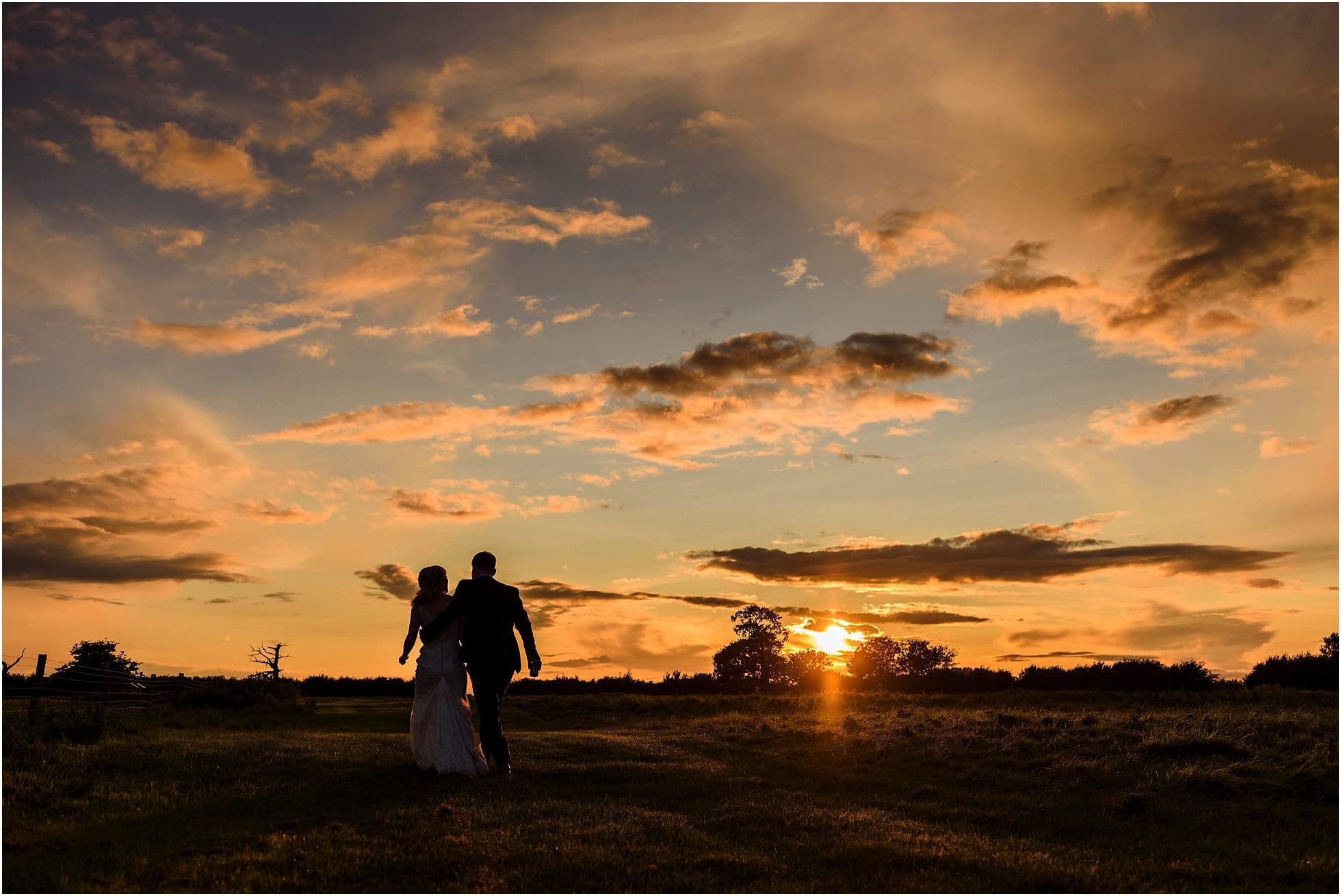 Norfolk Wedding Photographer sunset shot at Godwick Great Barn & Hall