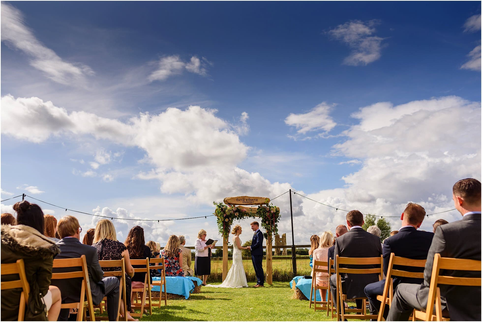 godwick hall wedding ceremony outside by a Norfolk Wedding Photographer