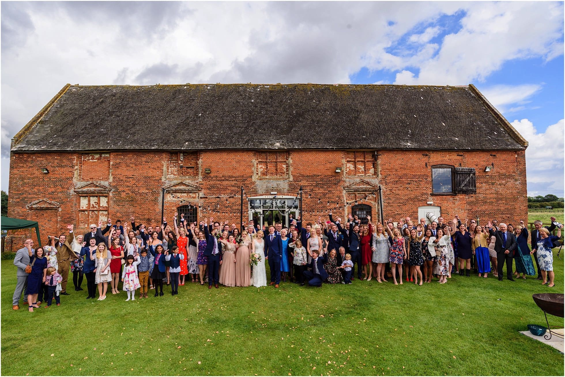whole group shot in front of godwick great barn