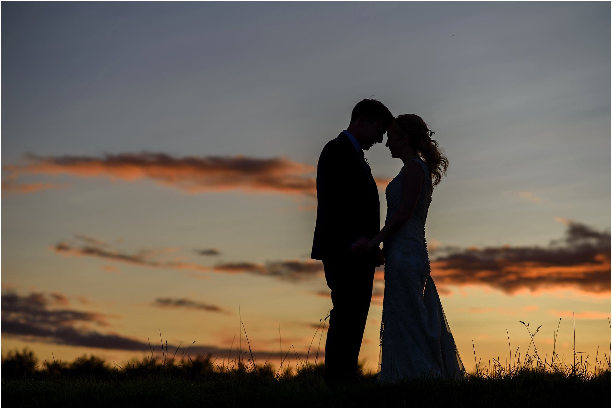 silhouette sunset shot at godwick great barn wedding